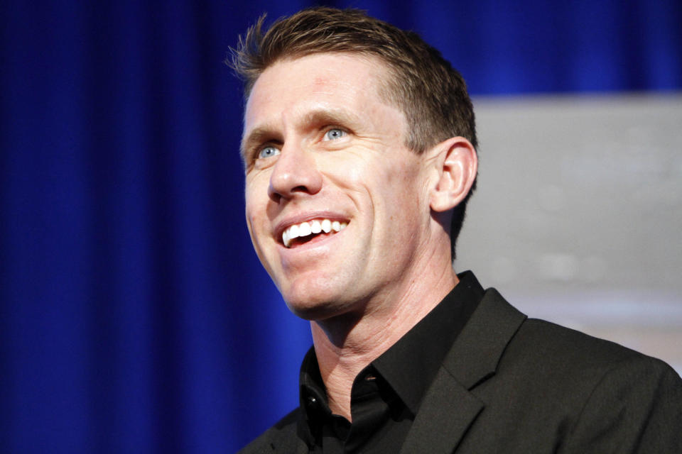 Retired NASCAR driver Carl Edwards speaks at his induction into the speedway's hall of fame at Texas Motor Speedway, Saturday, Nov. 3, 2018, in Fort Worth, Texas. (AP Photo/David Kent)