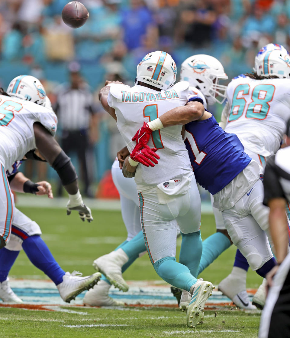 Miami Dolphins quarterback Tua Tagovailoa (1) is sacked by Buffalo Bills defensive end A.J. Epenesa (57) during the first quarter of an NFL football game Sunday, Sept. 19, 2021, in Miami Gardens, Fla. A battery of tests run on Tagovailoa failed to show any serious problems other than bruised ribs, raising at least the possibility that he could play next weekend when the Dolphins (1-1) visit the Las Vegas Raiders (2-0). (David Santiago/Miami Herald via AP)