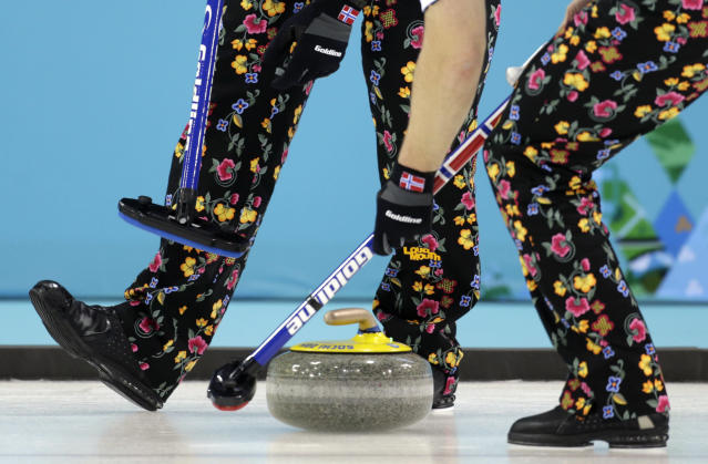 <p>Norway wears pants with a rose painting design during men's curling competition against Canada at the 2014 Winter Olympics, Friday, Feb. 14, 2014, in Sochi, Russia. (AP Photo/Robert F. Bukaty) </p>