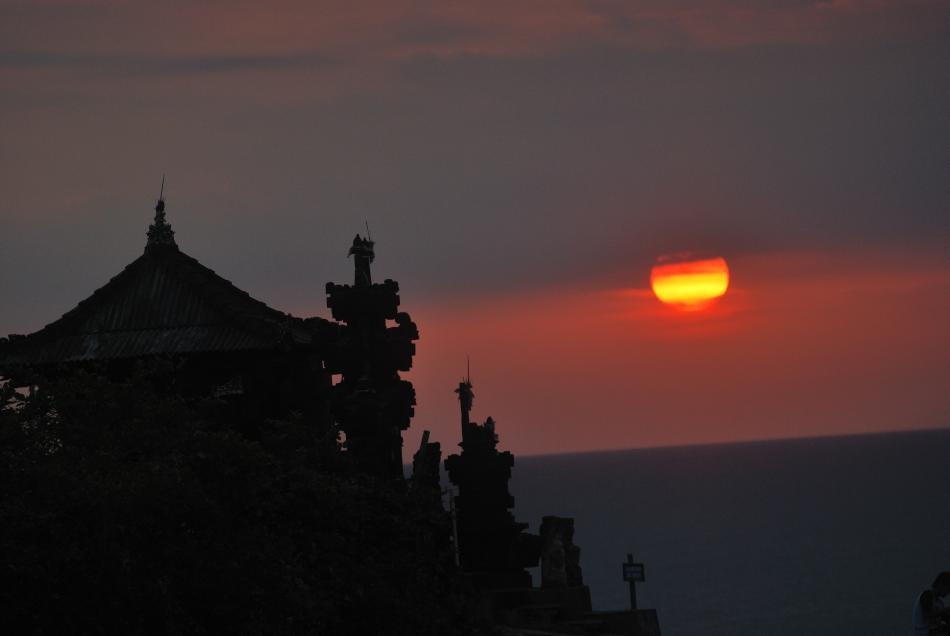<b>Sunset at Tanah Lot temple in Bali, Indonesia</b><br><br>No trip is complete without a glimpse of the spectacular sunset in Tanah Lot temple, a tourist magnet located on a rocky oceanic island. The 15th century shrine, dedicated to the sea spirits, was built under the direction of a priest and is believed to be guarded by snakes.