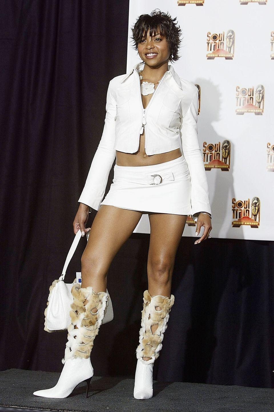 <p>Taraji P. Henson finished off her white mini skirt and jacket look with a matching fur purse-and-boot combo.</p>