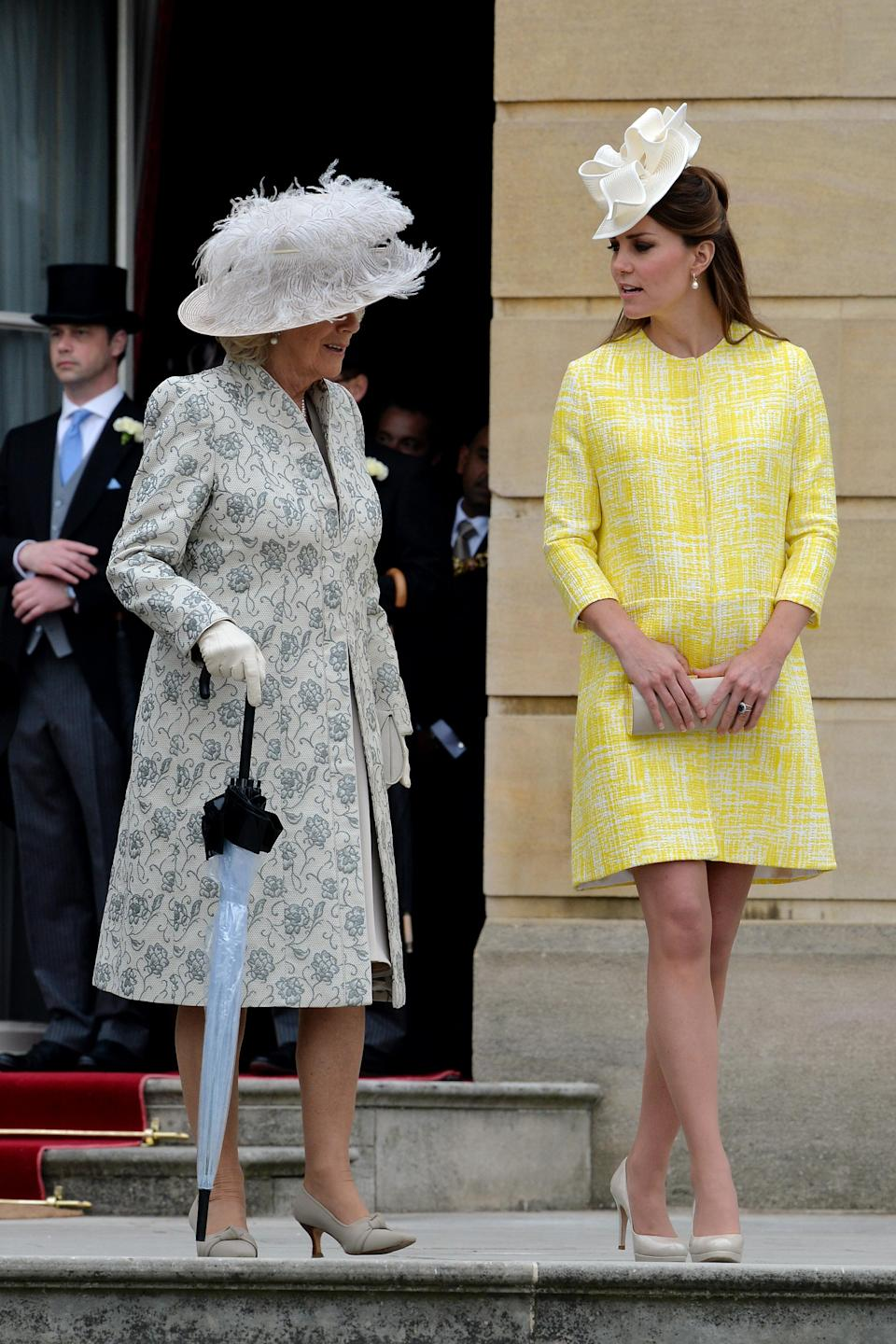 <p>Kate wore a sunny yellow coat by Emilia Wickstead for the Queen's garden party at Buckingham Palace in May 2013. <em>[Photo: Getty]</em> </p>