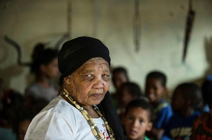 Katrina Esau, one of the last remaining speakers of a Khoi San language, Tuu, teaches her native tongue to children in this 2015 picture. Once widely spoken, Tuu was forcibly replaced by Afrikaans under apartheid, and in 1978 was declared extinct