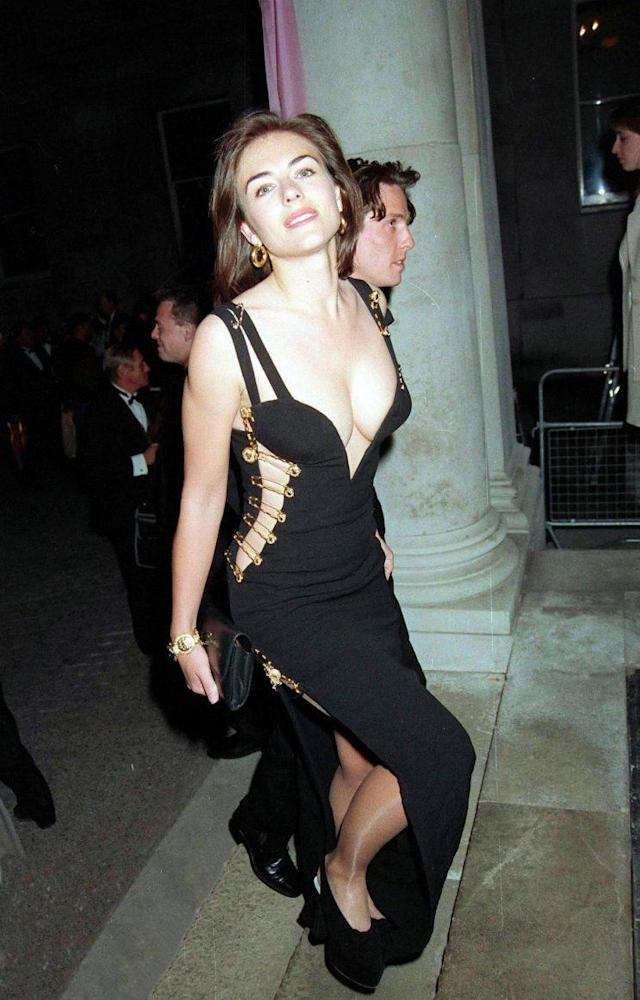Elizabeth Hurley wears the now-famous 1994 Versace safety pin dress. (Photo: Getty images)