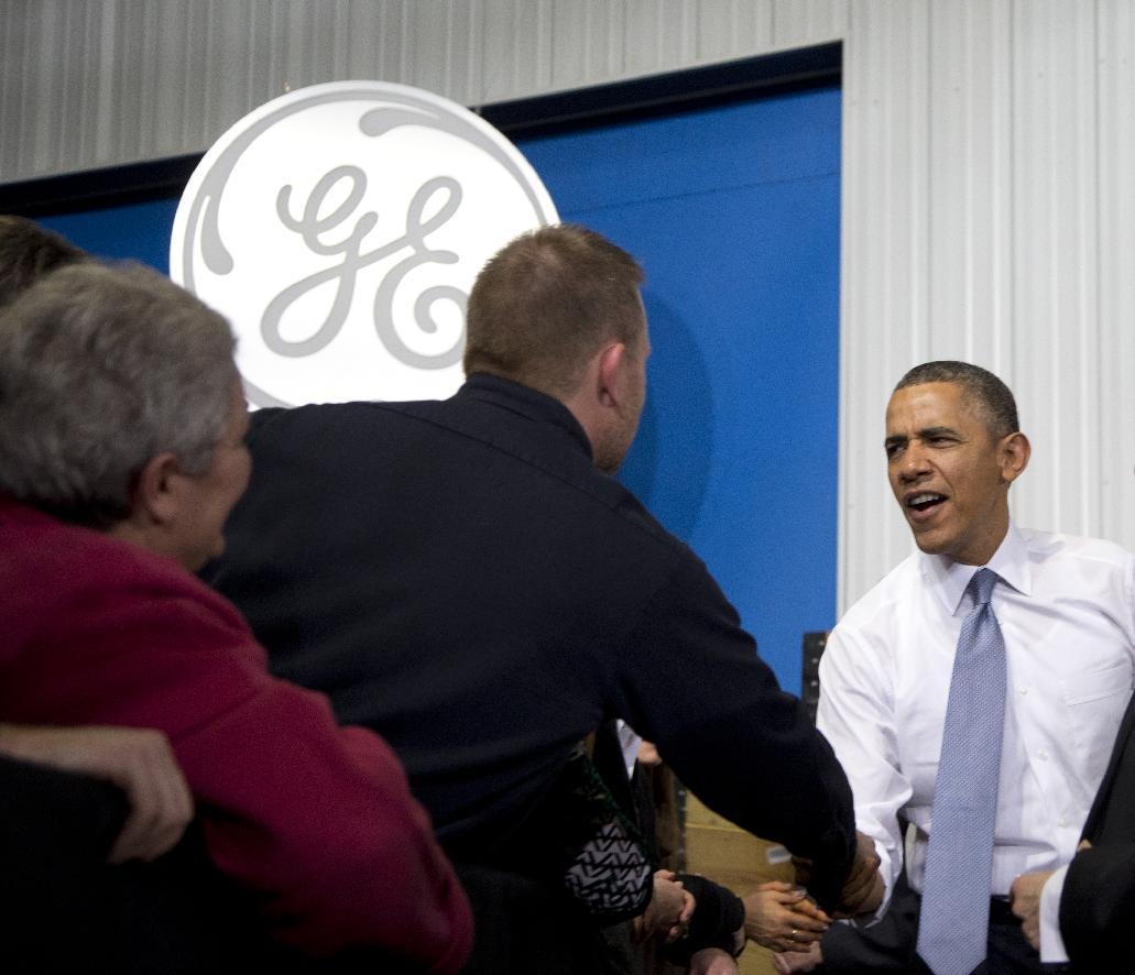 President Barack Obama greets people in the audience as he arrives to speak at General Electric's Waukesha Gas Engines facility, Thursday, Jan. 30, 2014, in Waukesha, Wis. This trip to Waukesha, Wis., is part of a four-stop tour President Barack Obama is making to expand on themes from his State of the Union address. (AP Photo)
