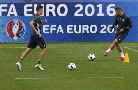 Football Soccer - Euro 2016 - Germany Training - Stade Camille Fournier, Evian-Les-Bains, France - 9/6/16 - Germany's Lukas Podolski and Julian Weigl during training. REUTERS/Denis Balibouse
