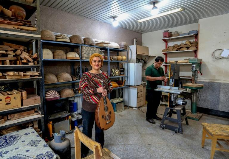 """Fatemeh Moussavi crafts ouds in her studio in Tehran, an art which Iran and Syria are lobbying to be added to UNESCO's """"intangible heritage"""" list"""