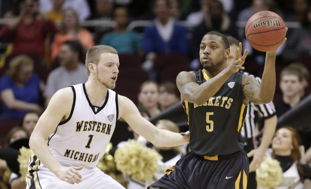 Toledo's Rian Pearson (5) passes against Western Michigan's Tucker Haymond during the first half of an NCAA college basketball championship game at the Mid-American Conference tournament on Saturday, March 15, 2014, in Cleveland. (AP Photo/Tony Dejak)
