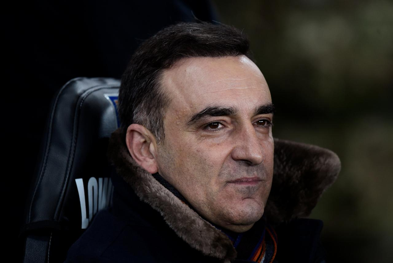 """Soccer Football - Premier League - Swansea City vs Liverpool - Liberty Stadium, Swansea, Britain - January 22, 2018   Swansea City manager Carlos Carvalhal before the match    REUTERS/Rebecca Naden    EDITORIAL USE ONLY. No use with unauthorized audio, video, data, fixture lists, club/league logos or """"live"""" services. Online in-match use limited to 75 images, no video emulation. No use in betting, games or single club/league/player publications.  Please contact your account representative for further details."""