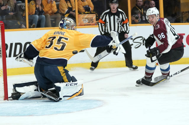 Colorado Avalanche right wing Mikko Rantanen (96), of Finland, fires a shot that sails under the outstretched arm of Nashville Predators goalie Pekka Rinne (35), of Finland, during the first period in Game 5 of an NHL hockey first-round playoff series Friday, April 20, 2018, in Nashville, Tenn. (AP Photo/Sanford Myers)