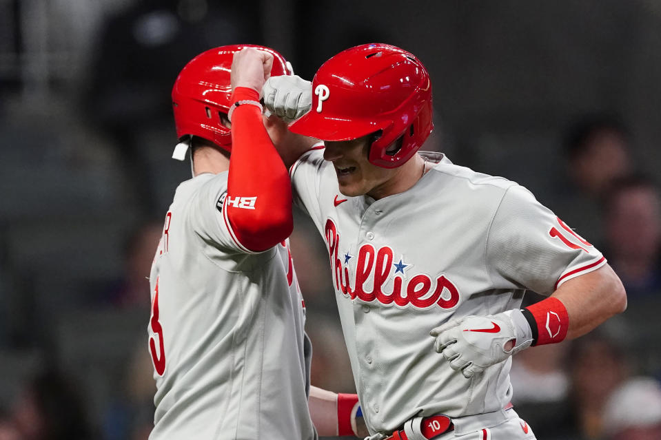 Philadelphia Phillies' J.T. Realmuto, right, celebrates with Bryce Harper after hitting a two-run home run in the eighth inning of a baseball game against the Atlanta Braves, Friday, May 7, 2021, in Atlanta. (AP Photo/John Bazemore)