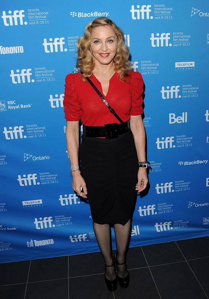 "Madonna dressed demurely to promote her new movie, ""W.E.,"" at the Toronto International Film Festival at the TIFF Bell Lightbox on Monday. For once, the ""Material Girl""-turned-director must have wanted the spotlight on the flick, not her wardrobe! Jason Merritt/<a href=""http://www.gettyimages.com/"" target=""new"">GettyImages.com</a> - September 12, 2011"