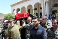 Mourners carry the coffin of Ahmed Jibril, founder of pro-Syrian Palestinian guerrilla faction during his funeral in Damascus