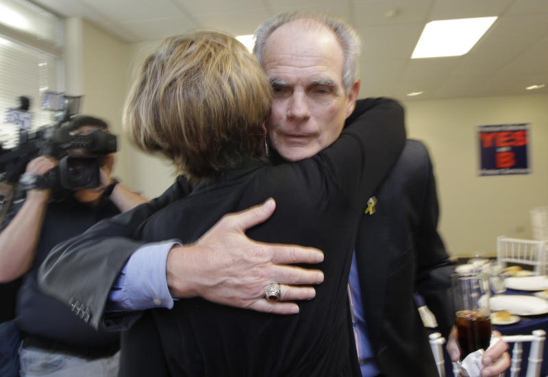 San Jose Mayor Chuck Reed, right, hugs former San Jose Vice Mayor Pat Dando at a campaign party in San Jose, Calif., Tuesday, June 5, 2012.  As state and local governments across the country struggle with ballooning pension obligations, voters in two major California cities cast ballots Tuesday on sweeping measures to curb retirement benefits for government workers. Reed, a Democrat, joined an 8-3 City Council majority to put San Jose Measure B on pension reform on the ballot. (AP Photo/Paul Sakuma)