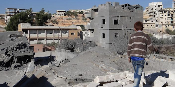 Debris are seen following a US-led coalition airstrike hits Headquarters of al Nusra Front in Aleppo, Syria on November 06, 2014.