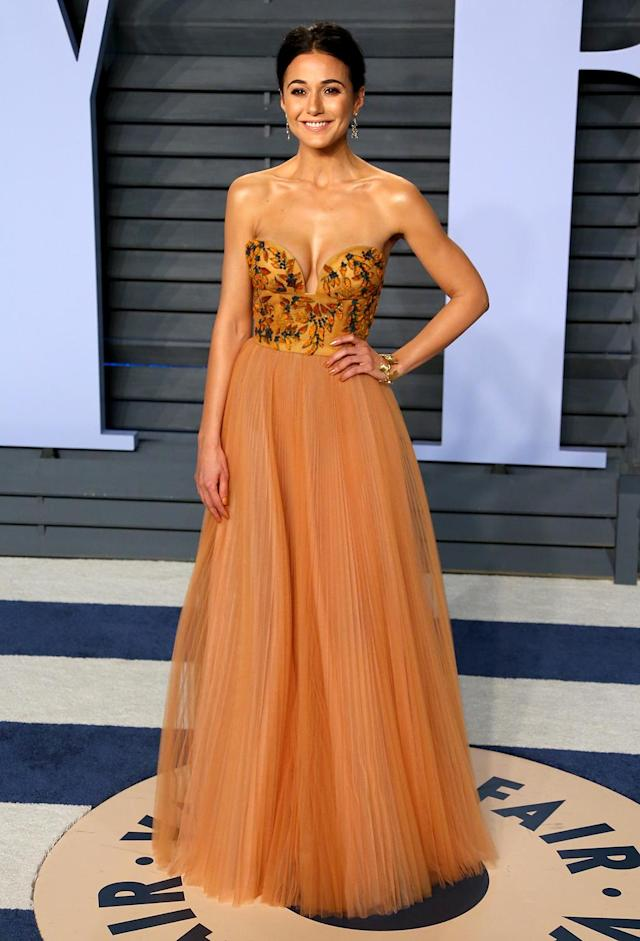 <p>One of many celebrities to arrange outfit changes for each party, Chriqui's Oscars wardrobe included this strapless number. (Photo: JEAN-BAPTISTE LACROIX/AFP/Getty Images) </p>