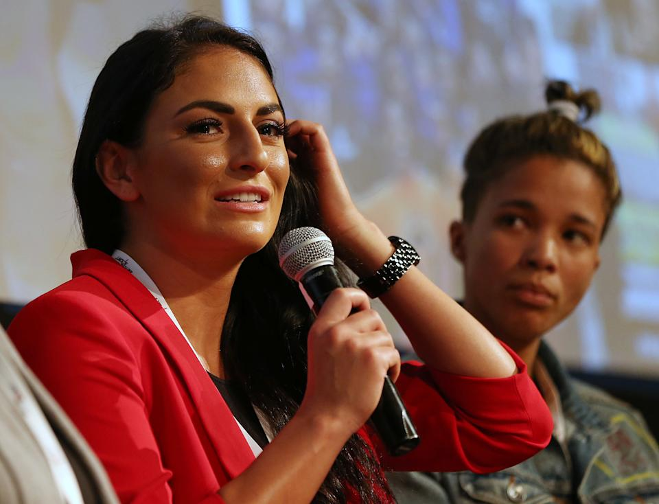 Sonya Deville talks during a news conference.
