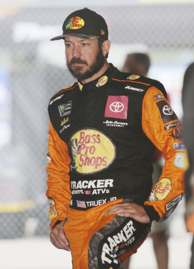 Martin Truex Jr. waits in the garage for a NASCAR Cup Series auto race practice to begin on Friday, Nov. 15, 2019, at Homestead-Miami Speedway in Homestead, Fla. Truex is one of four drivers racing for the series championship. (AP Photo/David Grahm)