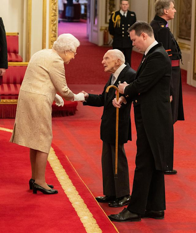 She shook hands with honours recipients with the gloves on. (Press Association)