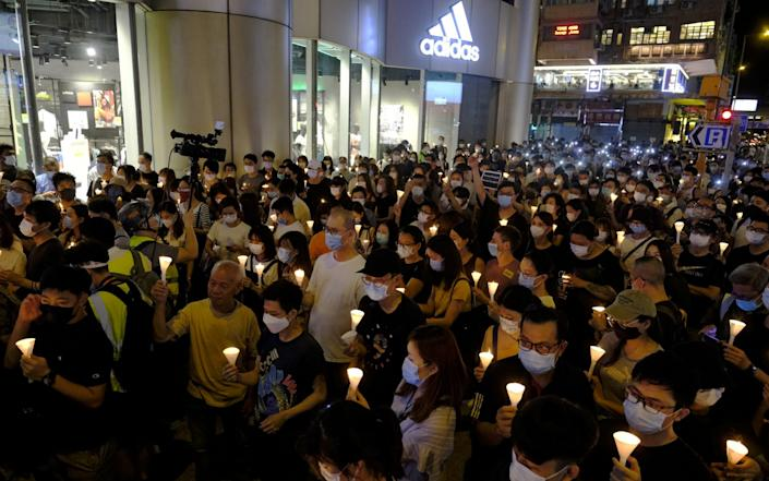 People gather in Hong Kong to the commemorate the 31st anniversary of the Tiananmen Square crackdown, despite an unprecedented ban on doing so - Roy Liu/Bloomberg
