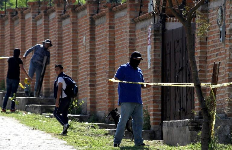 Authorities at work in  the El Mirador neighborhood of Tlajomulco de Zuniga in Jalisco, Mexico, where the remains of at least 50 people were found in a mass grave