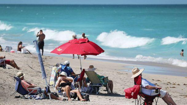 PHOTO: People enjoy the weather, on May 04, 2020, in Jensen Beach, Fla. Restaurants, retailers, as well as beaches and some state parks reopened May 4 with caveats, as the state continues to ease restrictions put in place to contain COVID-19. (Joe Raedle/Getty Images)