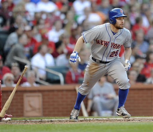 New York Mets' Daniel Murphy (28) watches his two-run double against the St. Louis Cardinals' in the second inning in a baseball game Monday, May 13, 2013, at Busch Stadium in St. Louis. (AP Photo/Bill Boyce)