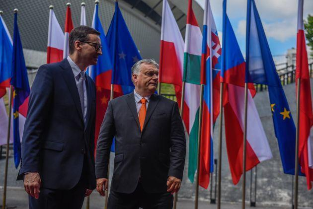 KATOWICE, POLAND - JUNE 30: Poland's Prime Minister, Mateusz Morawiecki welcomes the Prime Minister of Hungary, Viktor Orban during a Heads of State meeting of the Visegrad group at International Congress Center on June 30, 2021 in Katowice, Poland. The heads of state of Poland, Hungary, Slovakia and the Czech Republic have gathered as Poland closes the Visegrad presidency and passes it to the Hungarian Government. (Photo by Omar Marques/Getty Images) (Photo: Omar Marques via Getty Images)