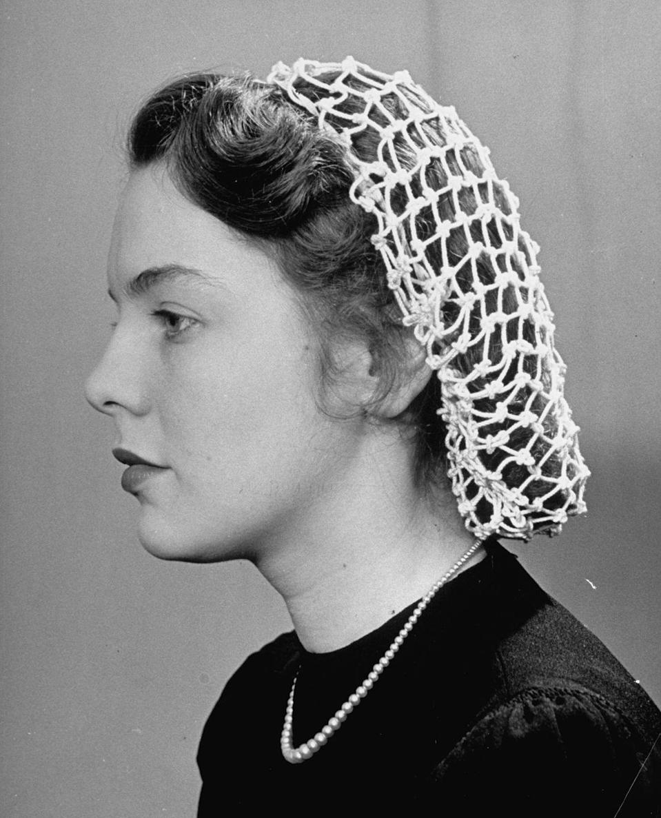 <p>Worn during World War II by women employed in factories, this headpiece, made of cloth or yarn, held women's hair away from their neck. </p>