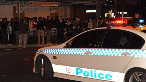 This file photo shows Australian police attempting to disperse gangs in Sydney, in 2009. An escalating gun war in Sydney saw five overnight drive-by shooting attacks, Australian police said Tuesday, as they struggled to bring the gangland violence under control