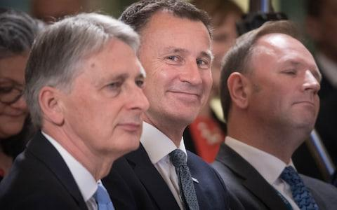 Philip Hammond, Jeremy Hunt and NHS chief executive Simon Stevens - Credit: Getty Images/Getty Images