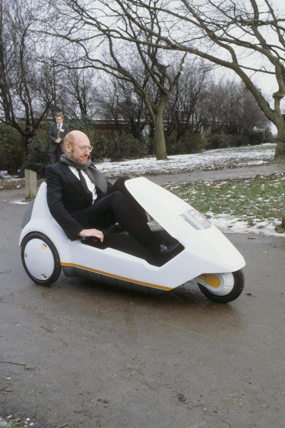Sir Clive Sinclair demonstrating his C5 electric vehicle (PA) (PA Archive)