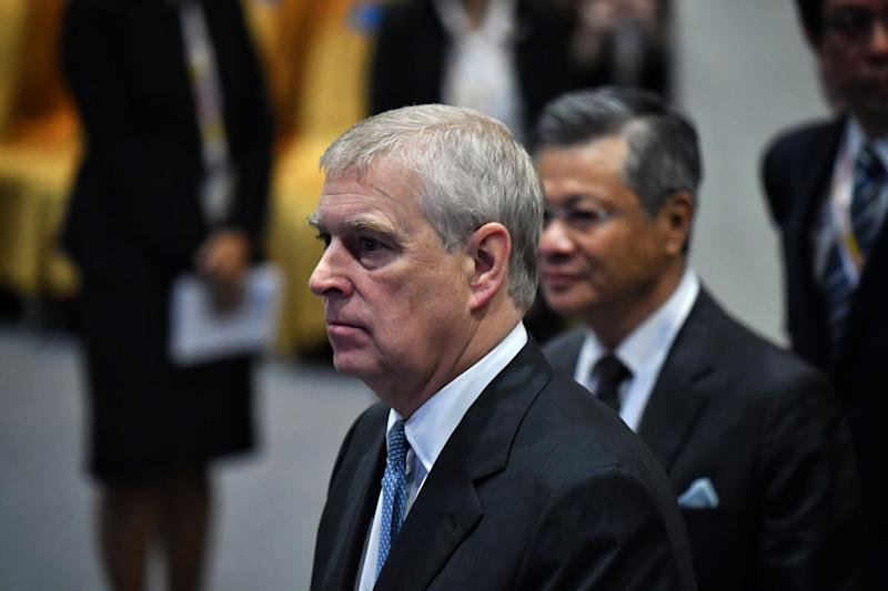 Britain's Prince Andrew, Duke of York (L) arrives for the ASEAN Business and Investment Summit in Bangkok on November 3, 2019, on the sidelines of the 35th Association of Southeast Asian Nations (ASEAN) Summit. (Photo by Lillian SUWANRUMPHA / AFP) (Photo by LILLIAN SUWANRUMPHA/AFP via Getty Images)