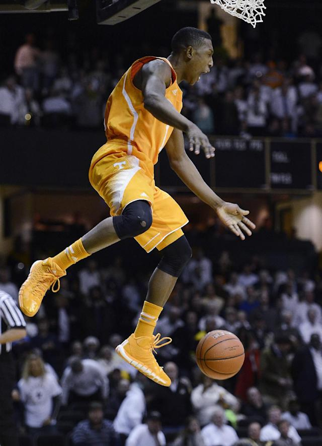 Tennessee guard Josh Richardson (1) reacts after opening the game with a break-a-way dunk in the first half of an NCAA college basketball game against Vanderbilt, Wednesday, Feb. 5, 2014, in Nashville, Tenn. (AP Photo/Mark Zaleski)