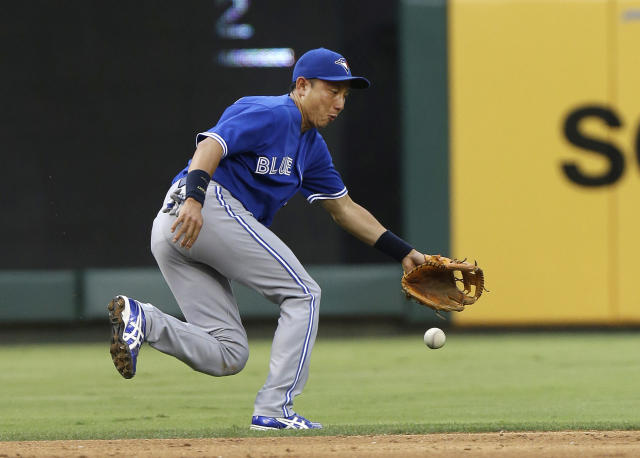Toronto Blue Jays shortstop Munenori Kawasaki of Japan cannot reach a ball hit for a single by Texas Rangers Adrian Beltre, not shown, during the second inning of a baseball game Friday, June 14, 2013, in Arlington, Texas. (AP Photo/LM Otero)