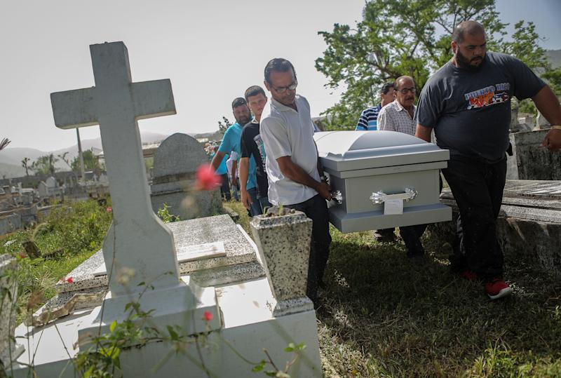 Mourners in Utuado, Puerto Rico, carry the casket of Wilfredo Torres Rivera, 58, who killed himself three weeks after Hurricane Maria. His family said he suffered from depression and schizophrenia and was caring for his 92-year-old mother in a home without electricity or water in the aftermath of the storm.