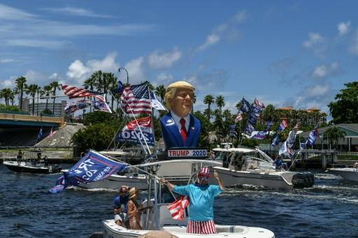 """A boat decked out with Donald Trump paraphernalia participates in a """"Trumptilla,"""" a flotilla for the US president's birthday, on June 14, 2020 in Fort Lauderdale, Florida"""