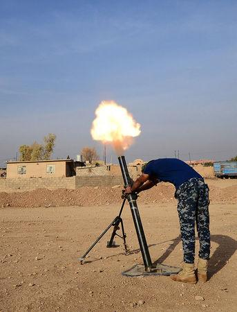 Federal police forces fire mortar toward Islamic State militants south of Mosul, Iraq, November 9, 2016. Picture taken November 9, 2016. REUTERS/Stringer