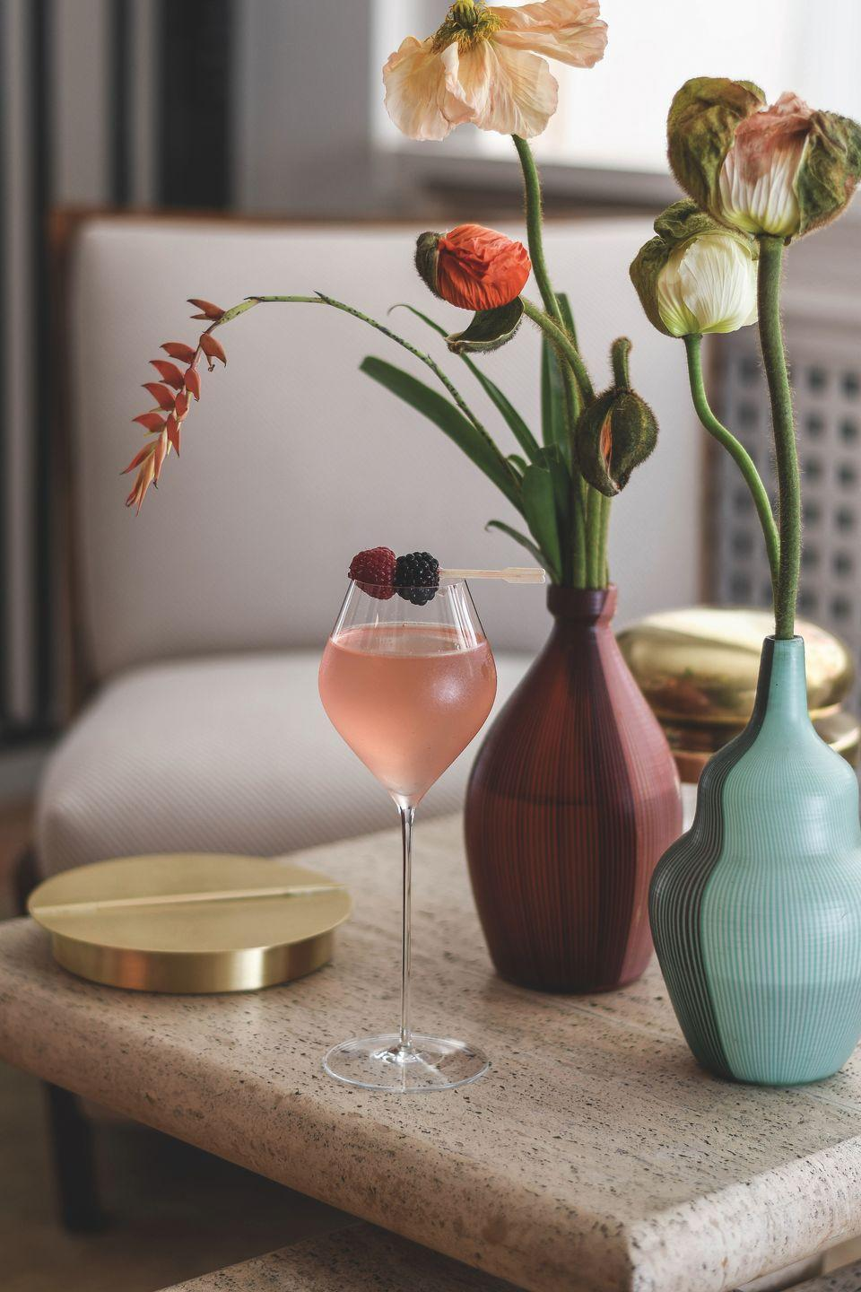 """<p>This delicate and feminine cocktail was created by <a href=""""https://www.belmond.com/hotels/europe/italy/portofino/belmond-splendido-mare/"""" rel=""""nofollow noopener"""" target=""""_blank"""" data-ylk=""""slk:Splendido Mare, a Belmond Hotel"""" class=""""link rapid-noclick-resp"""">Splendido Mare, a Belmond Hotel</a> to honor Ava Gardner, who notoriously adored Champagne and all-things pink. Gardner stayed at the hotel while filming the 1954 film, <em>Barefoot Contessa</em>, with Humphrey Bogart.</p><p><strong>Ingredients: </strong></p><p>25 mL London dry Gin</p><p>20 mL raspberry liquor</p><p> 15 mL Orange Curacao</p><p> 15 mL fresh lemon juice</p><p>5 mL simple syrup.</p><p>Dry sparkling wine</p><p>Directions:</p><p>Add first five ingredients into a cocktail shaker with ice, shake well, and top with Champagne Brut or a dry Prosecco.<br></p>"""