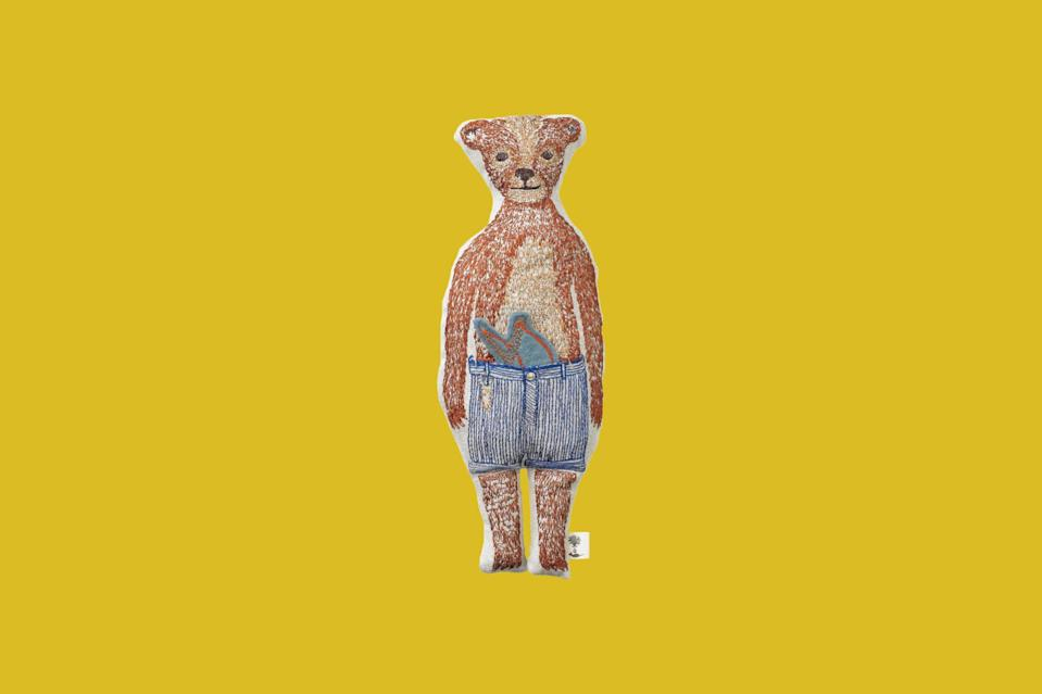 """<p>This charming character is heirloom quality, embroidered on 100 percent linen fabric and comes with a small slingshot accessory. Each stuffed toy begins as an original pencil drawing by Coral & Tusk's founder Stephanie Housley.</p> <p><strong><em>Shop Now:</em></strong><em> Coral & Tusk Bear Pocket Doll, $70, <a href=""""https://coralandtusk.com/products/bear-pocket-doll?variant=28369922359380"""" rel=""""nofollow noopener"""" target=""""_blank"""" data-ylk=""""slk:coralandtusk.com"""" class=""""link rapid-noclick-resp"""">coralandtusk.com</a></em><em>.</em></p>"""