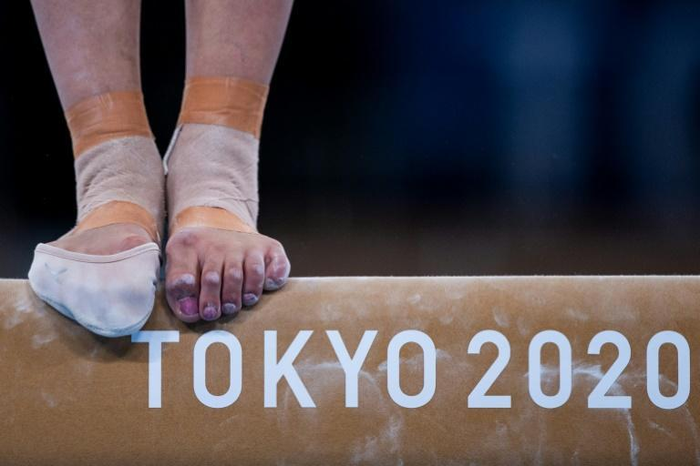 Gymnasts are in training before the start of competition on Saturday