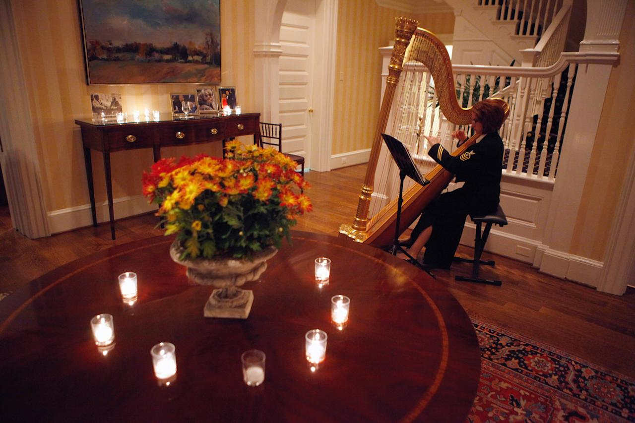 A military harpist plays music during a Thanksgiving dinner hosted by U.S. Vice President Joe Biden and his wife, Dr. Jill Biden, for about 10 sick and wounded members of the military and their families at the vice president's residence at the Naval Observatory November 22, 2010 in Washington, DC. For the second year in a row, the Bidens served turkey, green beans, caramel pumpkin pie and other traditional holiday dishes to the warriors and their families.  (Photo by Chip Somodevilla/Getty Images)