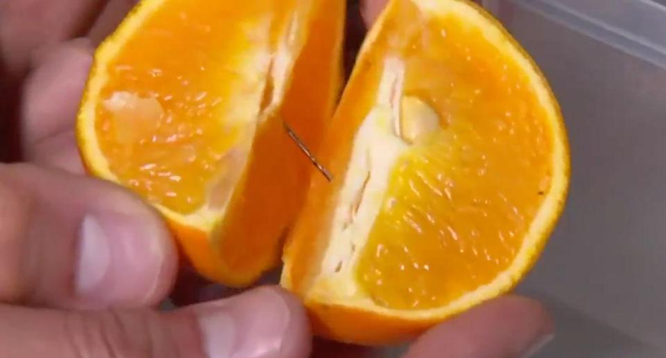 Maddie Sheridan, 4, asked her mum for a piece of fruit on Monday and found a needle inside her orange purchased from Woolworths, Casula. Source: 7 News