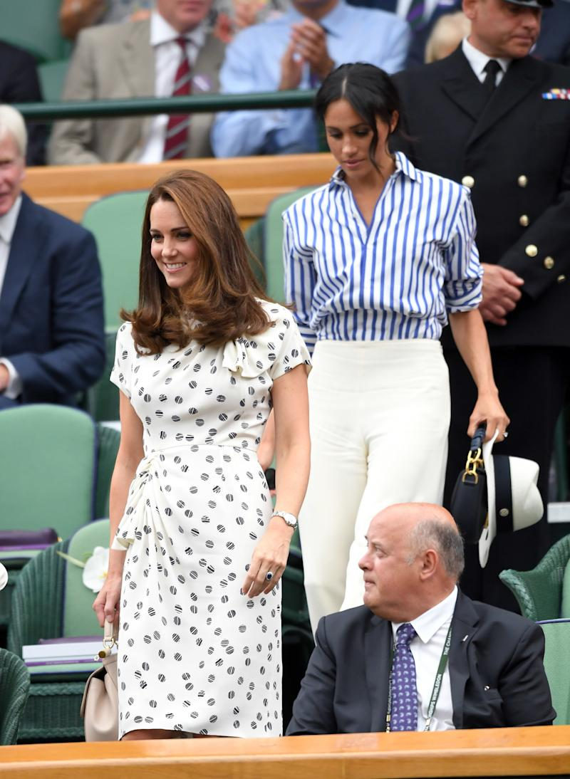 Catherine, Duchess of Cambridge and Meghan, Duchess of Sussex attend Day 12 of the Wimbledon Tennis Championships on July 14, 2018 in London, (Karwai Tang via Getty Images)