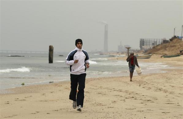 Gaza runner Bahaa al-Farra trains on a beach in Gaza City January 30, 2012.