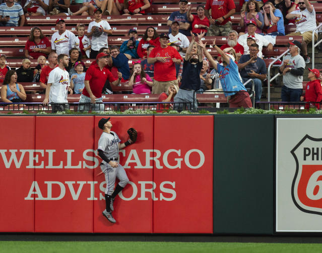 Miami Marlins centerfielder JT Riddle watches St. Louis Cardinals' Matt Carpenter's home run go over the fence during the third inning of a baseball game Monday, June 17, 2019, in St. Louis. (AP Photo/L.G. Patterson)