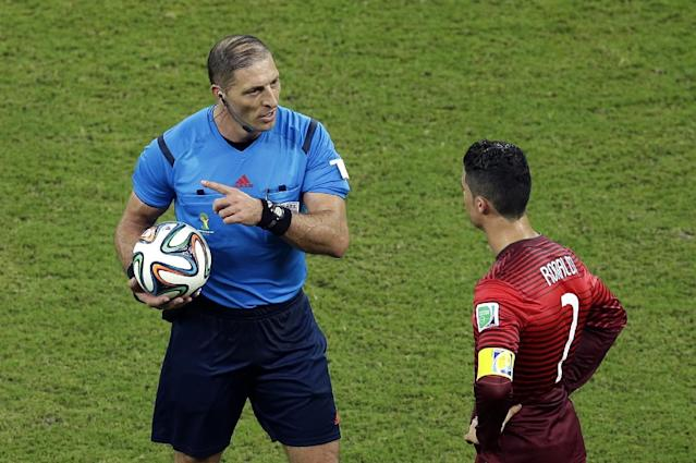 Portugal's Cristiano Ronaldo, right, talks to referee Nestor Pitana from Argentina during the group G World Cup soccer match between the USA and Portugal at the Arena da Amazonia in Manaus, Brazil, Sunday, June 22, 2014. (AP Photo/Themba Hadebe)