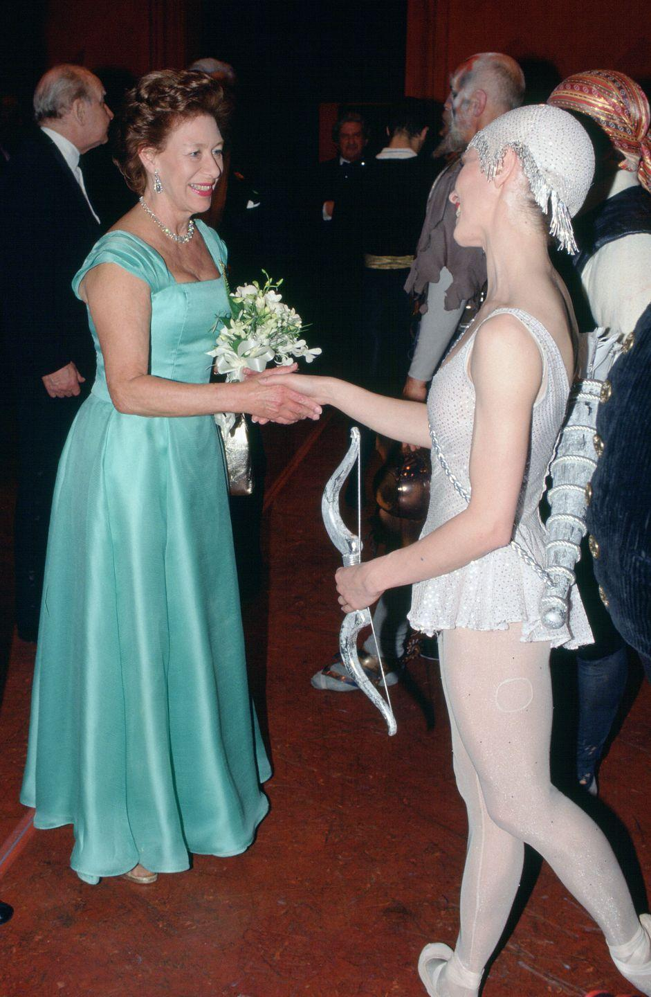 <p>Princess Margaret was a lifelong ballet enthusiast. Here she is making introductions as the president of the Royal Ballet in 1993. </p>