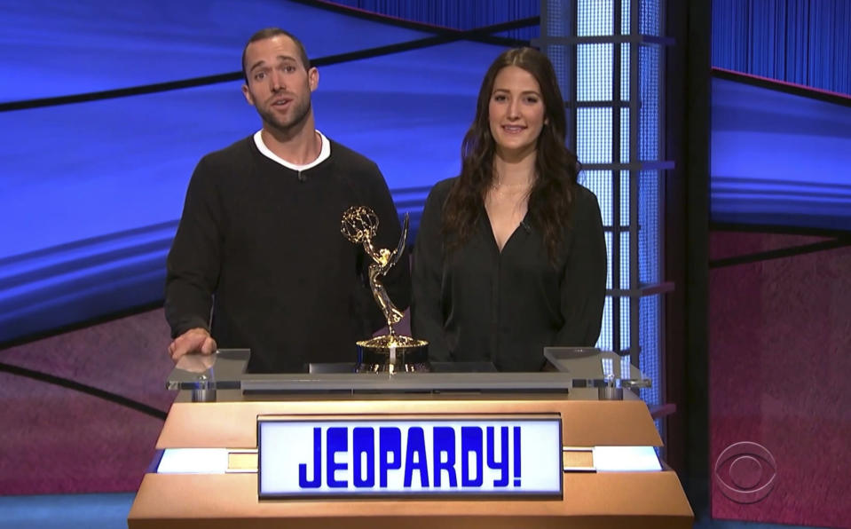 """In this video image provided by NATAS and the Daytime Emmys, Matt Trebek, left, and Emily Trebek, children of the late Alex Trebek, accept the award for outstanding game show host for """"Jeopardy!"""" on his behalf during the 48th Daytime Emmy Awards on Friday, June 25, 2021. (NATAS/Daytime Emmys via AP)"""