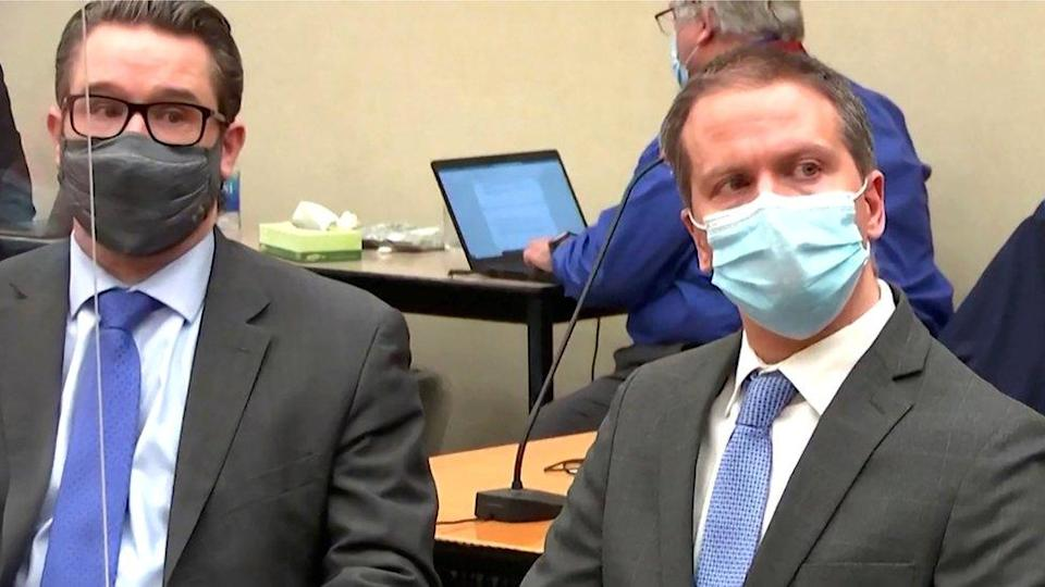 Former Minneapolis police officer Derek Chauvin with his defence lawyer Eric Nelson